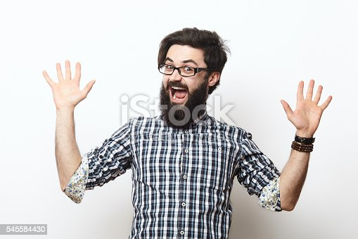 istock young man celebrating victory over white 545584430