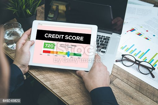 Young man checking Credit Score on Tablet Pc