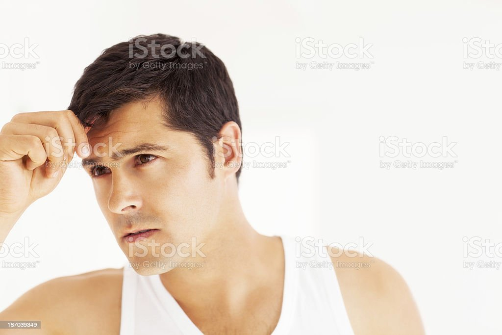Young Man Checking Hair In The Mirror royalty-free stock photo