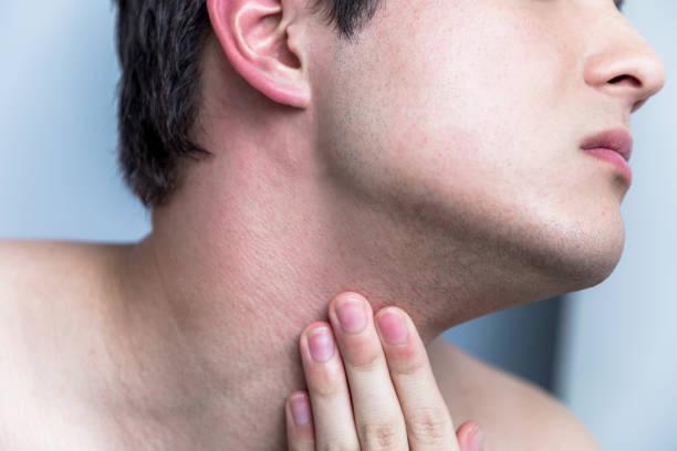 young man checking his facial skin. men's skincare concept. stock photo