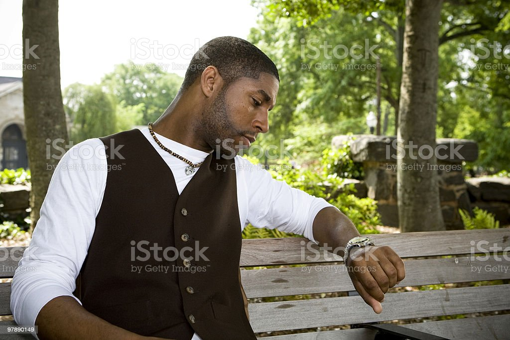Young Man Checking the Time royalty-free stock photo