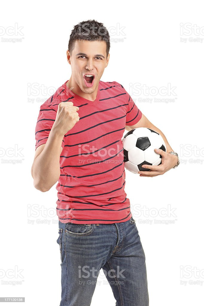 Young man cheering and holding a football royalty-free stock photo