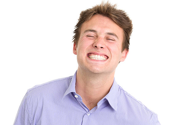 Young Man Cheesy Grin Portrait of a young man on a white background. http://s3.amazonaws.com/drbimages/m/ec.jpg cheesy grin stock pictures, royalty-free photos & images