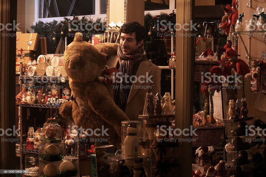 Young man Christmas shopping 免版稅 stock photo