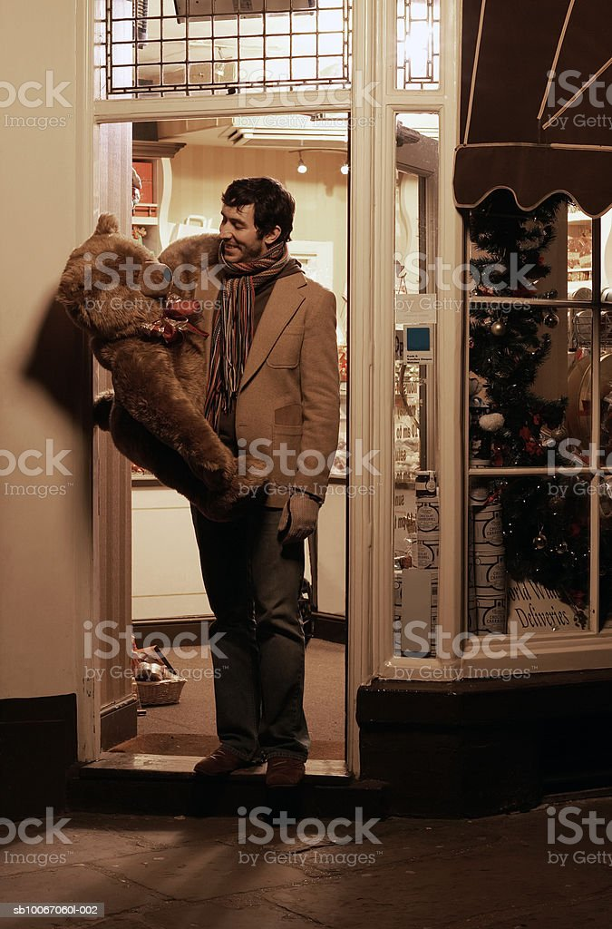 Young man Christmas shopping, smiling royalty-free stock photo
