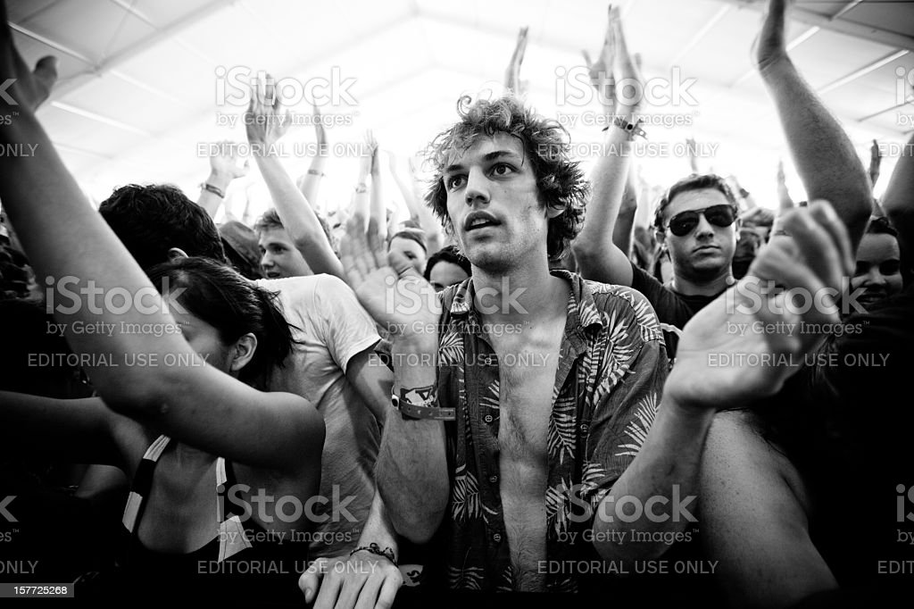 Young man clapping as he watches a performance stock photo