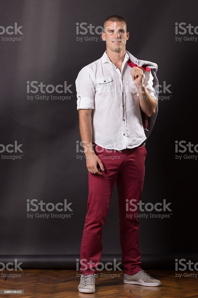 Young man classic posing portrait standing 20 years old pants royalty-free stock photo