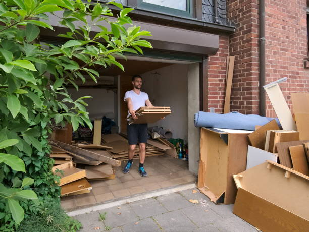 Young man cleaning out bulky waste on sidewalk Young, caucasian, white, 30 years old man carrying out bulky waste to the sidewalk remodel debris cleanup stock pictures, royalty-free photos & images