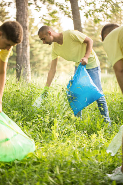 Young man cleaning up environment stock photo