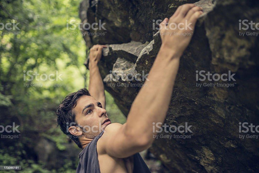 Young Man Climb Boulder stock photo