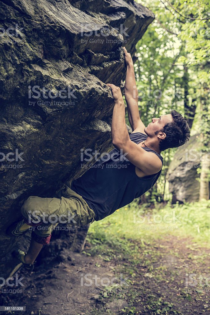 Young Man Climb Boulder royalty-free stock photo
