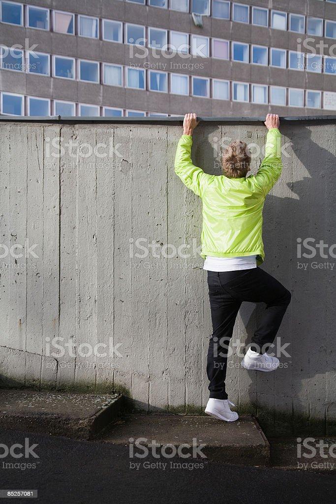 Young man climbing wall royalty-free stock photo