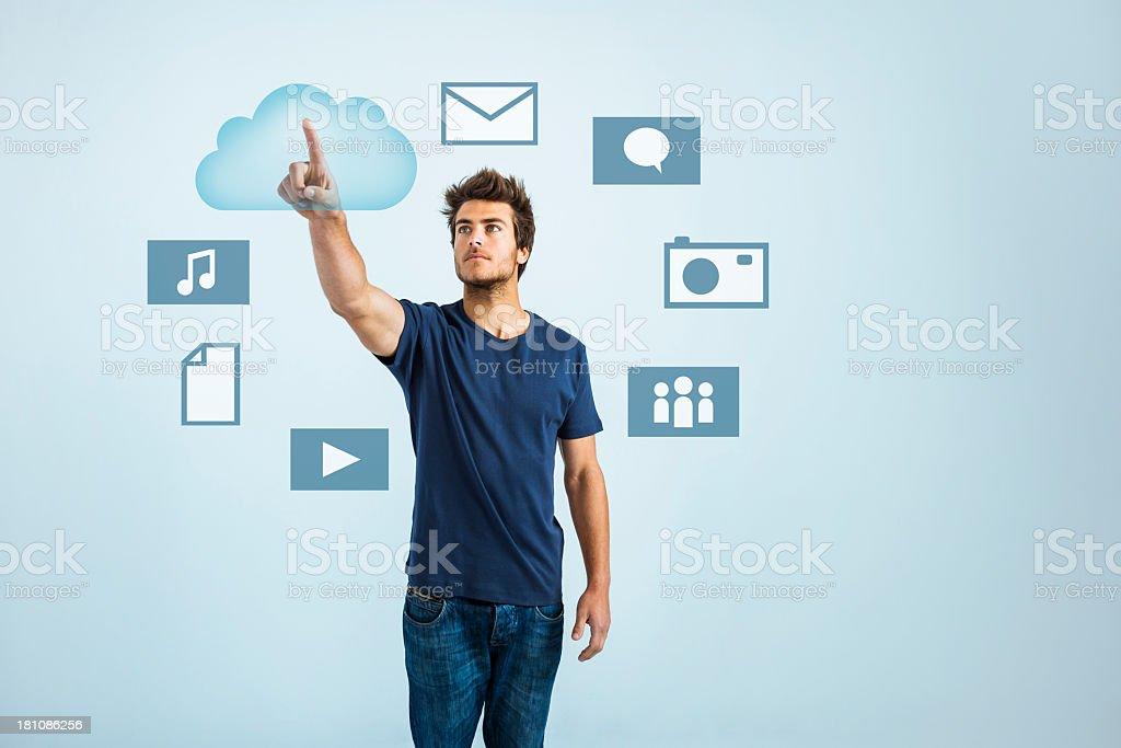 Young man cloud computing stock photo