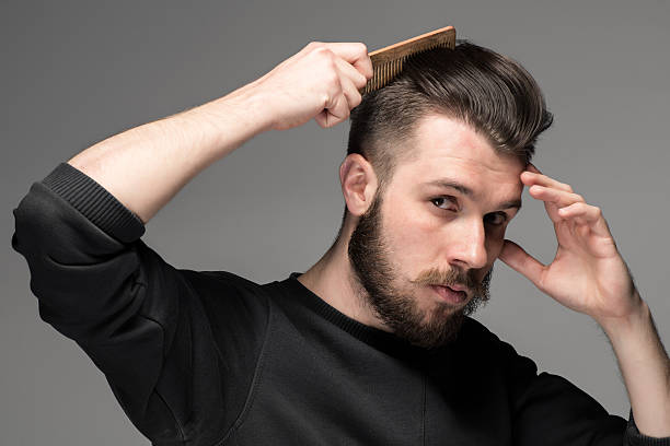 Man combing hair pictures images and stock photos istock young man comb his hair stock photo urmus Choice Image