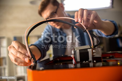 886646936 istock photo Young Man Connecting 3D Printer 886646992