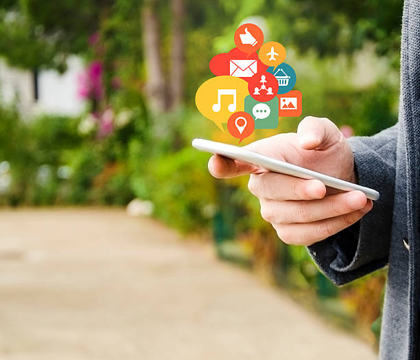 Young man connecting with social network stock photo