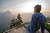 Young man contemplating view from top of Yosemite valley, USA