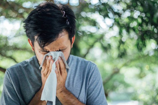Young Man coughing and covering mouth with a tissue , take care of your Health concept , Health care concept Young Man coughing and covering mouth with a tissue , take care of your Health concept , Health care concept mucus stock pictures, royalty-free photos & images