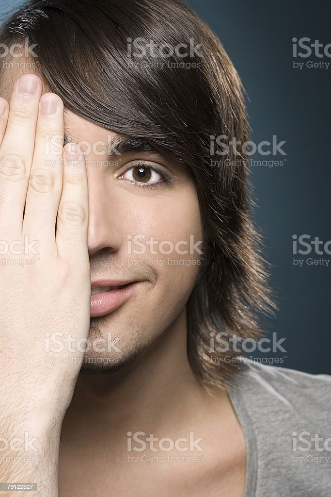 Young man covering his eye royalty-free 스톡 사진