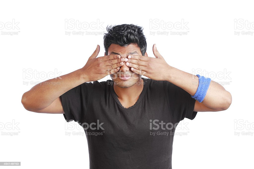 Young Man Covers Eyes With Hand royalty-free stock photo