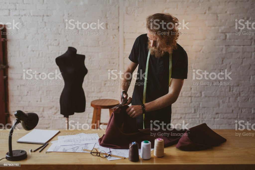 Young man creating clothing stock photo