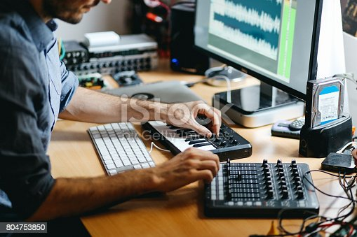 istock Young man creating music at home 804753850