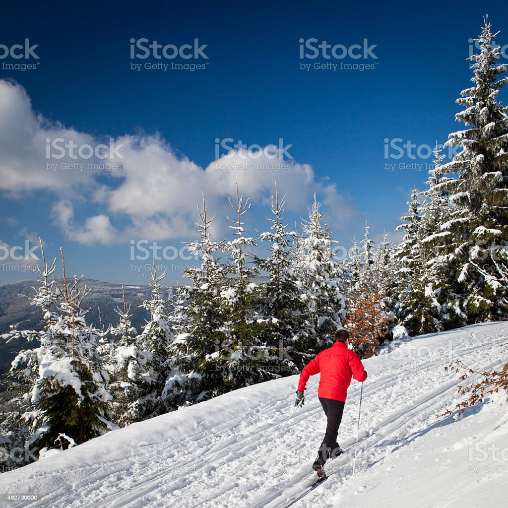 Young man cross-country skiing stock photo