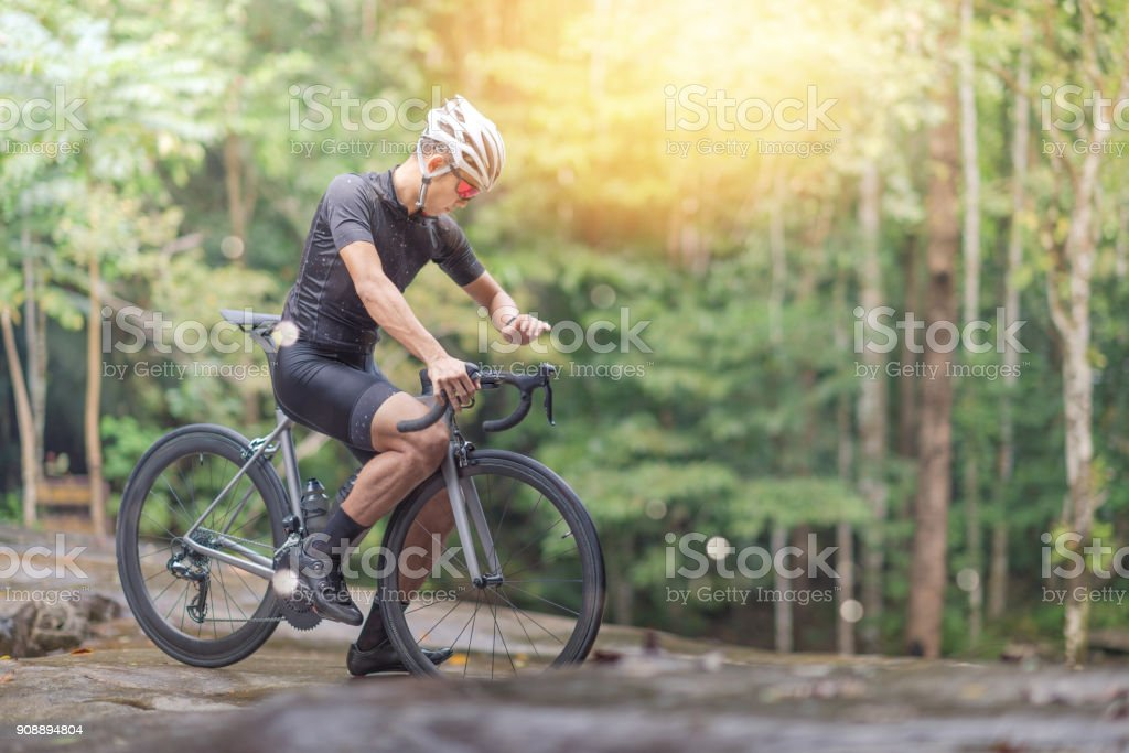 Young man Cyclist riding mountain bike in public park at moring stock photo