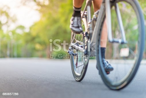 Young asian man Cyclist riding fitness mountain bike on trail at moring street