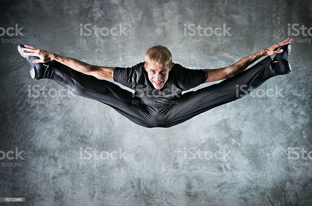 Young man dancer jumping up high stock photo