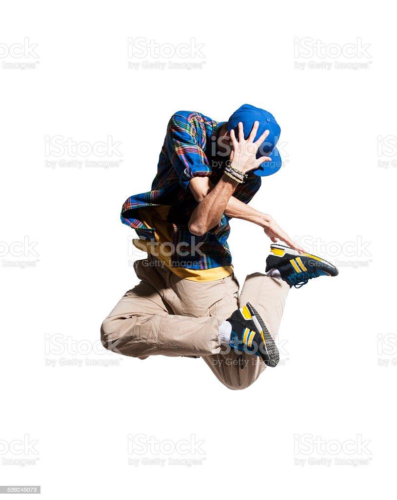 Young man dancer makes jump stock photo