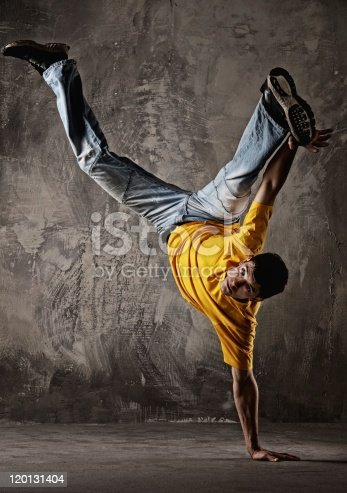 istock Young man dancing against grunge wall 120131404