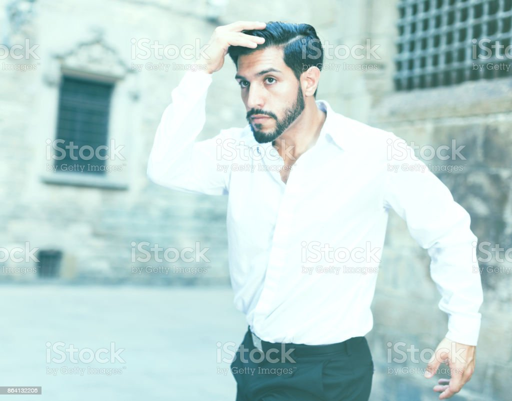 Young man dancing near old castle stock photo