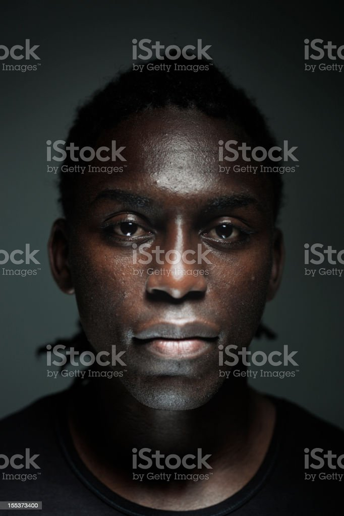 Young man dark portrait royalty-free stock photo