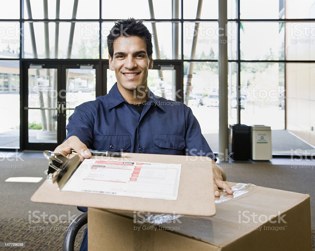 Young Man Delivering Boxes royalty-free stock photo