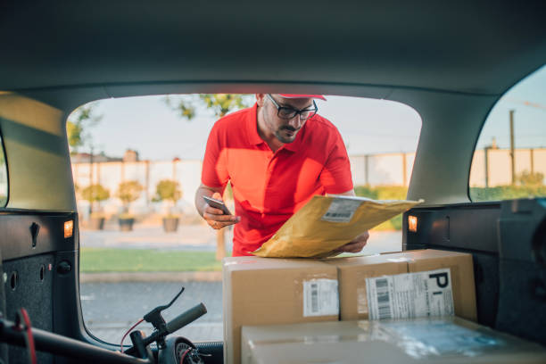 Young man delivering packages stock photo