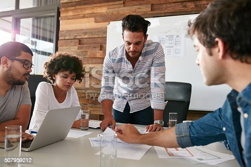 istock Young man discussing market research with colleagues 507959212