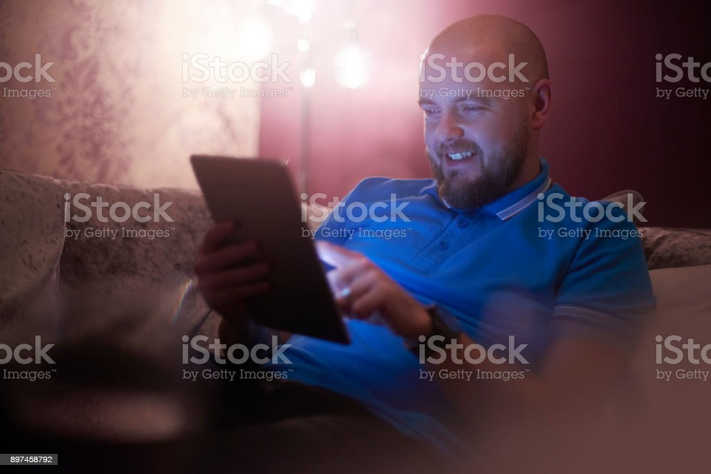 Young man doing a bit of online betting stock photo