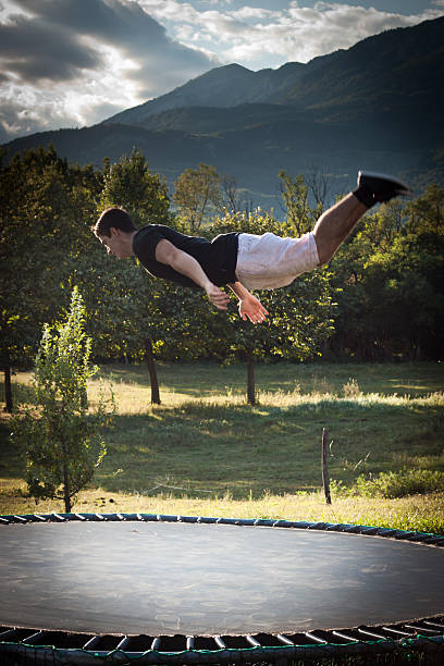 Young man doing backflip stock photo