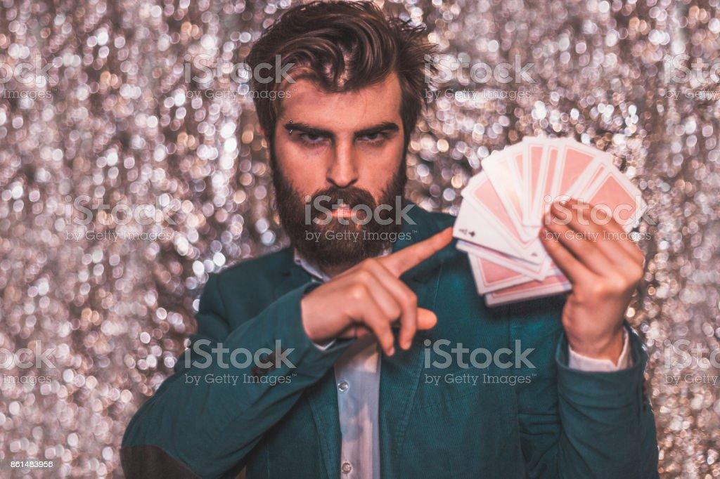 Young man doing cards tricks stock photo