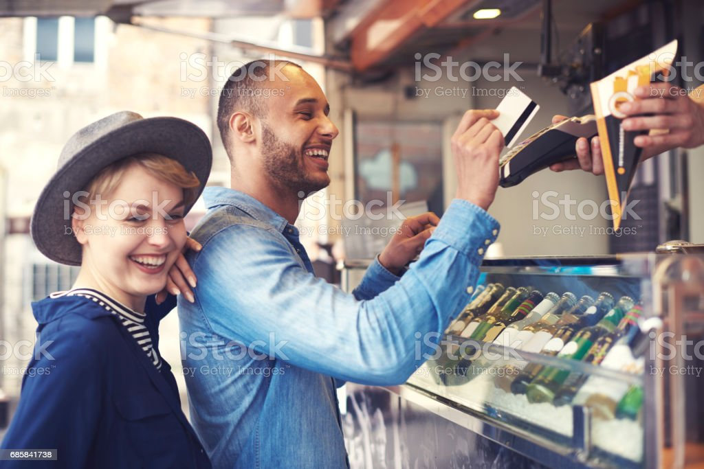 Young man doing contactless payment for fries stock photo