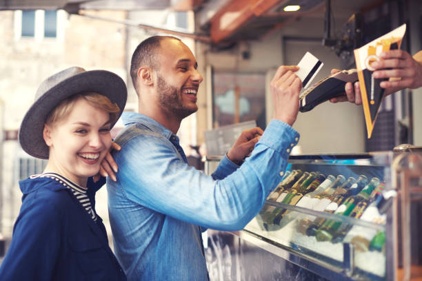 young man doing contactless payment for fries - being in a relationship with someone is going to require stock photos and pictures
