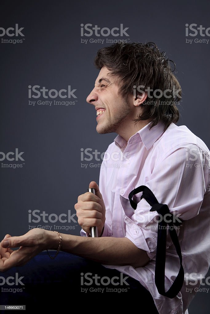 Young man doing drug injection stock photo