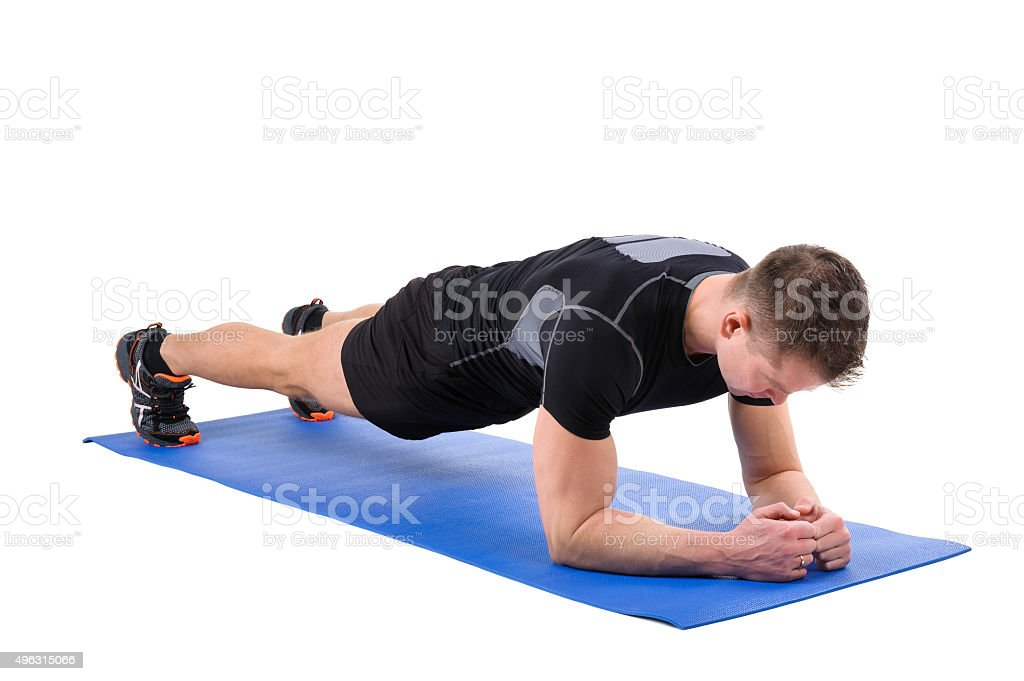 Young man doing Elbow Plank Workout stock photo