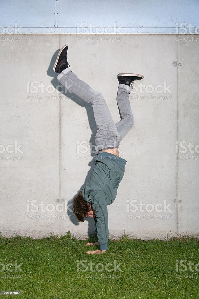 Young man doing handstand royalty-free stock photo