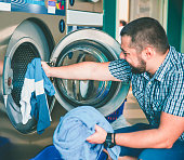 Young man doing laundry
