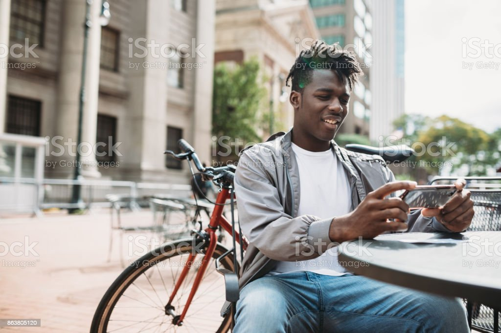 Young Man Doing Remote Deposit Capture of Check stock photo