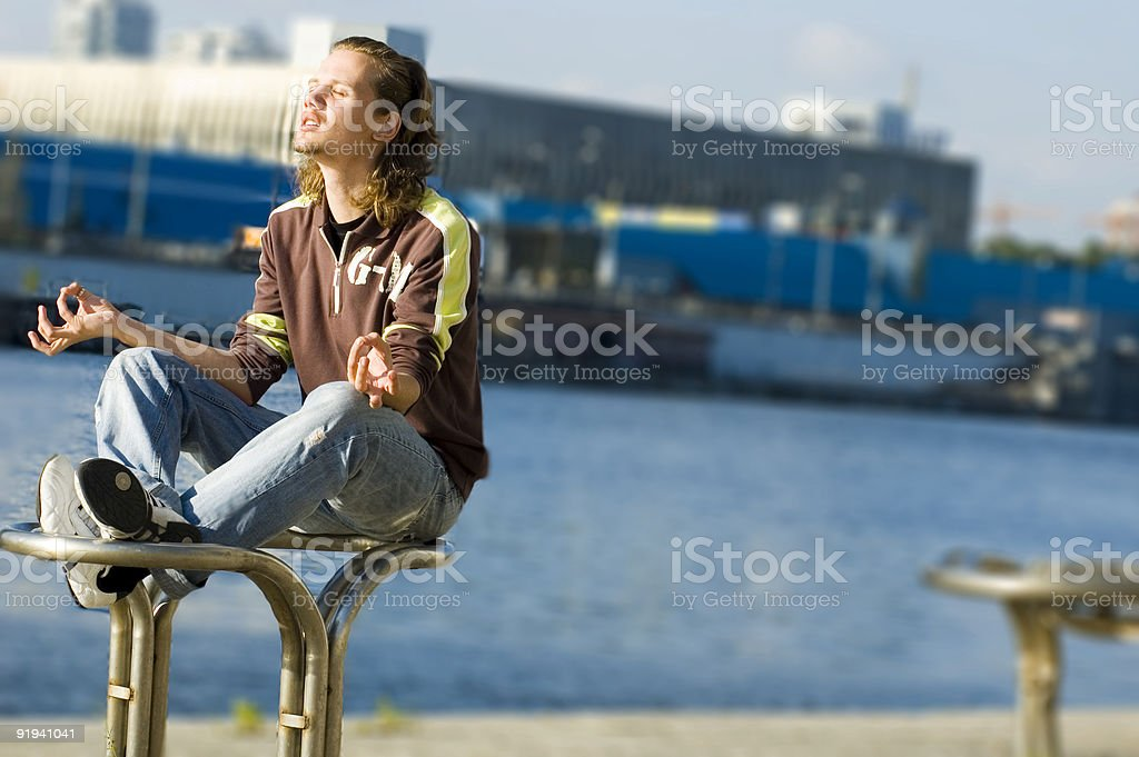 Young man doing yoga moves royalty-free stock photo
