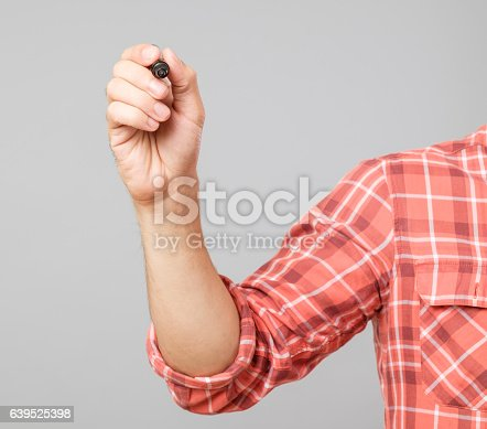 istock Young man drawing with marker 639525398