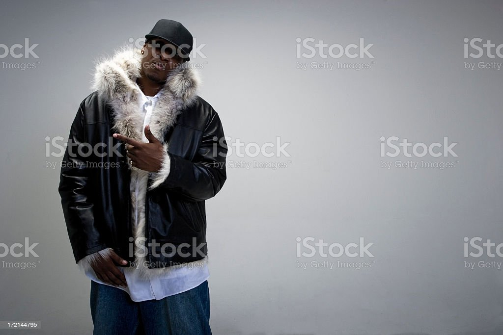 A young man dressed in fur and a cap stock photo